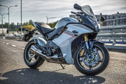 Warsaw, Poland - September 17, 2015: The 2012 Honda CBR 600 F motorcycle with ABS brakes parked on the road during sunny day. Honda is well known as sport motorcycles and cars production company.
