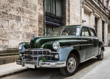 Havana, Cuba - March 02, 2016: Green american vintage car parked in Havana Cuba