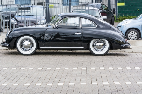 Velbert, Nrw, Germany - April 6, 2016: Black vintage Porsche 1600 with whitewall tires on a car park in Velbert city center, Germany.