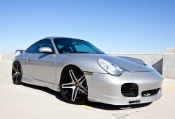 Scottsdale, United States - November 17, 2011: A photo of a parked silver 2002 Porsche Carerra. The Carerra from Porsche is known for its independent rear suspension and rear engine.